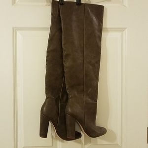 Over the knee, wide-calf heeled boots.